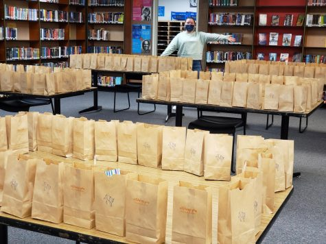 Mrs. Eggeling shows off the 500 gift bags being prepared for students.